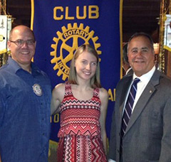 Emily Koerner with her father (left) and the past president of the club (right).